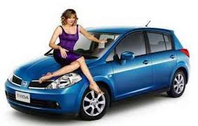 Blue Nissan Tiida with Kim Cattrell