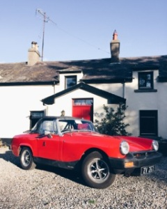 Red 1975 MG Midget